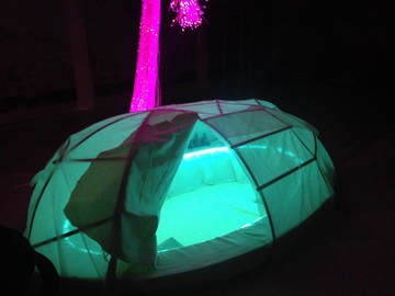 Pop-Up Type Cocoon Tent Lighted Up at Night